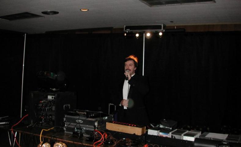 Disc Jockey Don Tilford Standing by Full Table of Audio And Lighting Equipment & Music